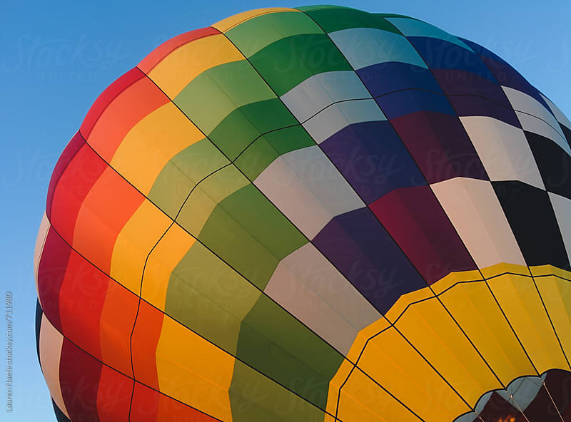 Colorful hot air balloon being inflated by Lauren Naefe for Stocksy United