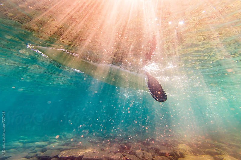 Underwater Photo of Kayak and Paddle with Sunshine in Freshwater Lake at Family Cottage by JP Danko for Stocksy United