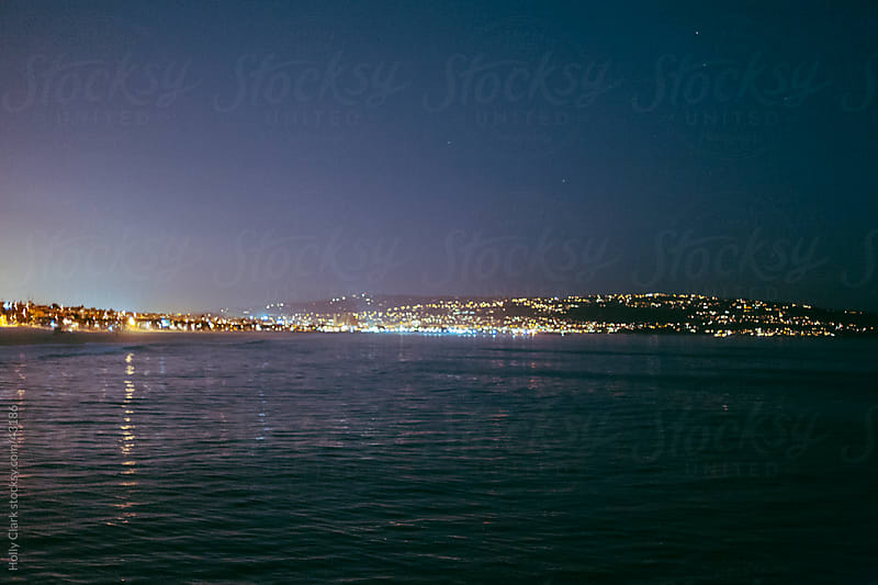 Ocean View of Lights at Night from the Manhattan Beach Pier by Holly Clark for Stocksy United