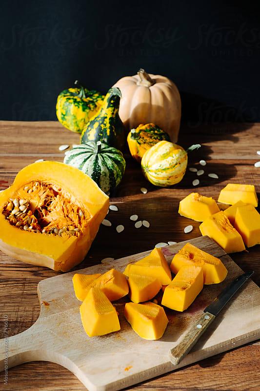 Pumpkin on a Cutting Board by Mosuno for Stocksy United