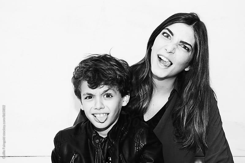 Handsome little boy with her sister by Guille Faingold for Stocksy United