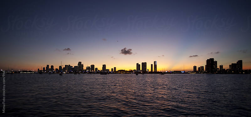 Panoramic view from Biscayne Bay to downtown Miami after Sunset by Mima Foto for Stocksy United