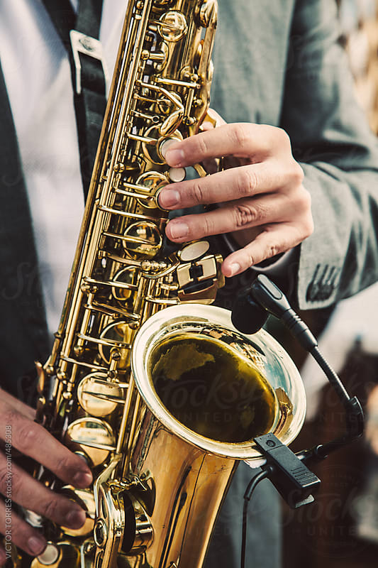 Man Playing Saxophone Outdoors by VICTOR TORRES for Stocksy United