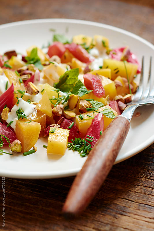 Beetroot and rhubarb salad by Harald Walker for Stocksy United