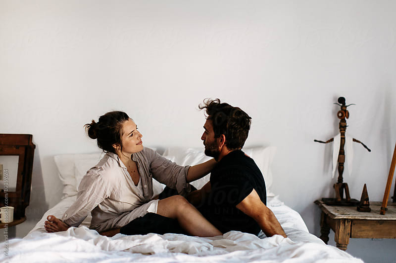 Man and woman in bed by Matt and Tish for Stocksy United