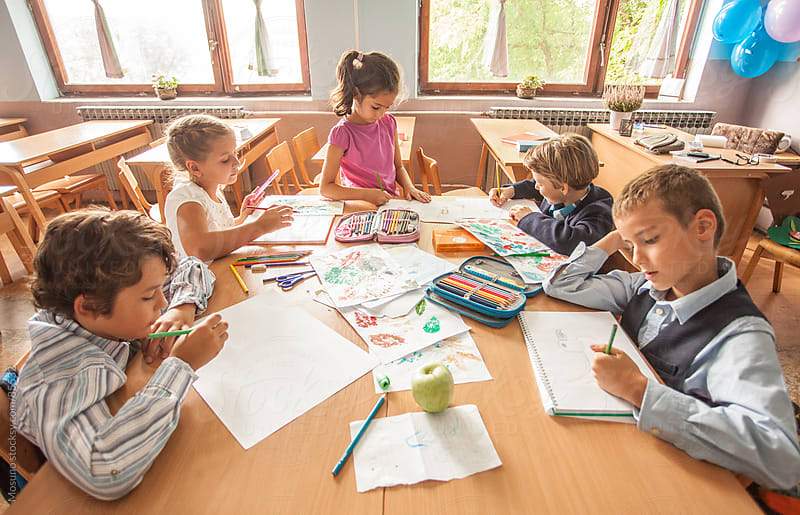 Schoolchildren Drawing in a Classroom by Mosuno for Stocksy United