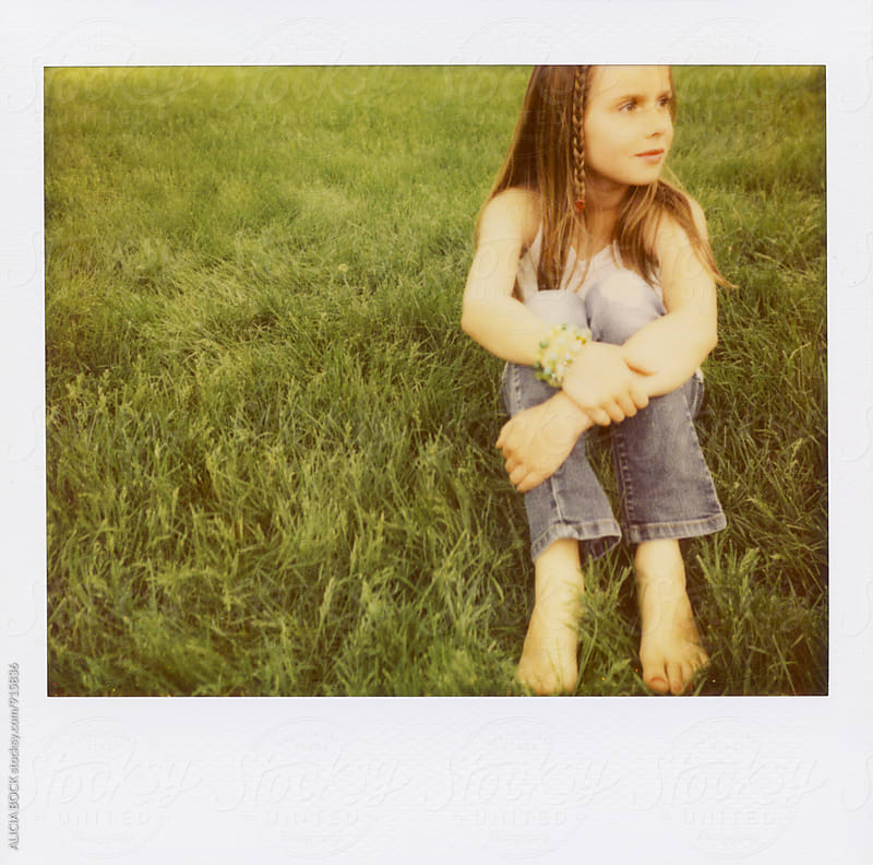 Polaroid Portrait Of A Girl Sitting In The Grass On A Spring Day by ALICIA BOCK for Stocksy United