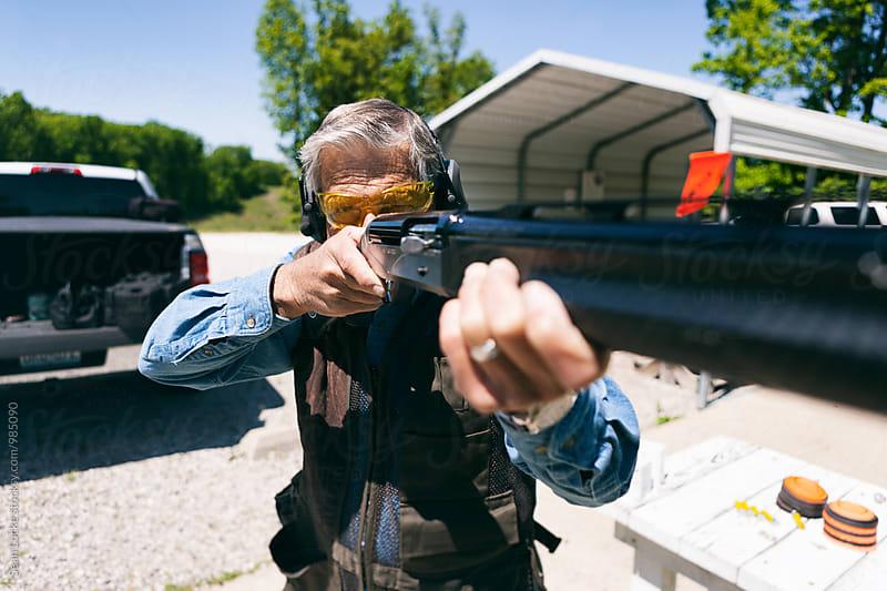 Shooting: Focus On Eyes Of Man Aiming Shotgun by Sean Locke for Stocksy United