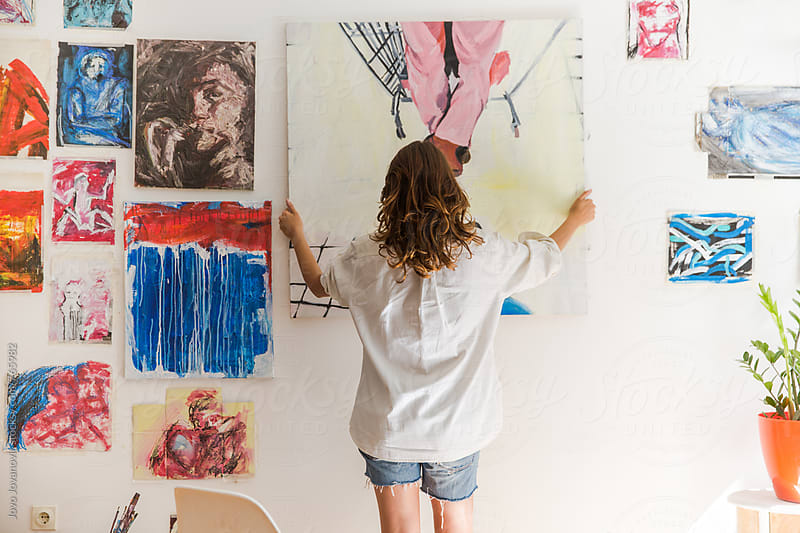 Artist working in her studio by Jovo Jovanovic for Stocksy United