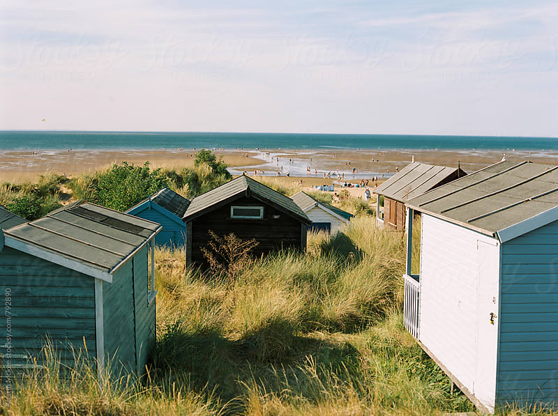 Beach huts with view of the beach, Hunstanton, Norfolk by Kirstin Mckee for Stocksy United