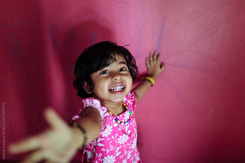 Little girl having fun by Saptak Ganguly for Stocksy United