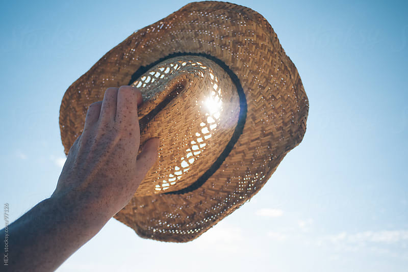 Make Shadow With Straw Hat . Summer by HEX. for Stocksy United