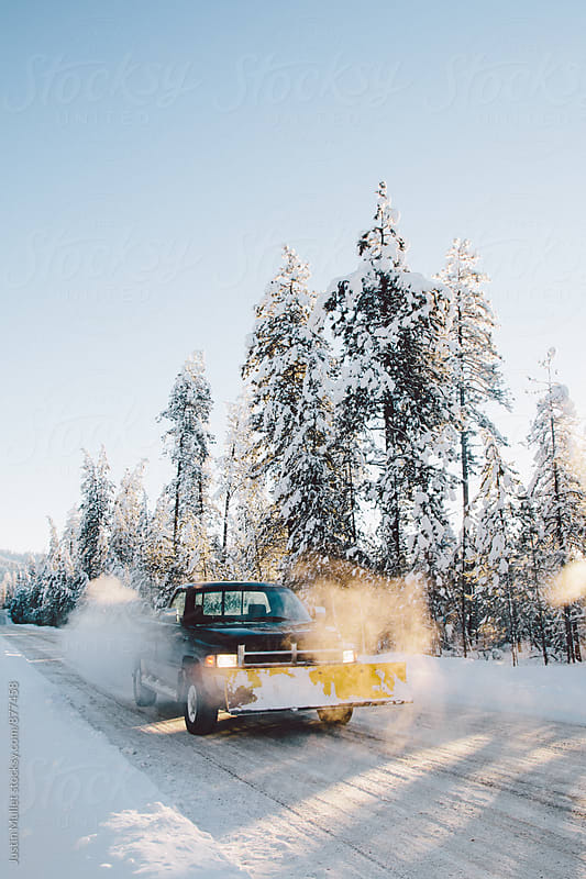 A truck and snow plow on a cold beautiful morning by Justin Mullet for Stocksy United