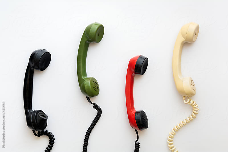Colorful rotary dial phone handsets by Pixel Stories for Stocksy United