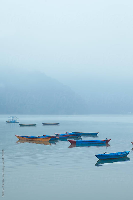 Fewa Lake in Pokhara on a cold foggy morning.  by Shikhar Bhattarai for Stocksy United