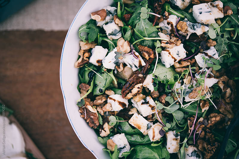 Salad with cheese and nuts by Adrian Cotiga for Stocksy United