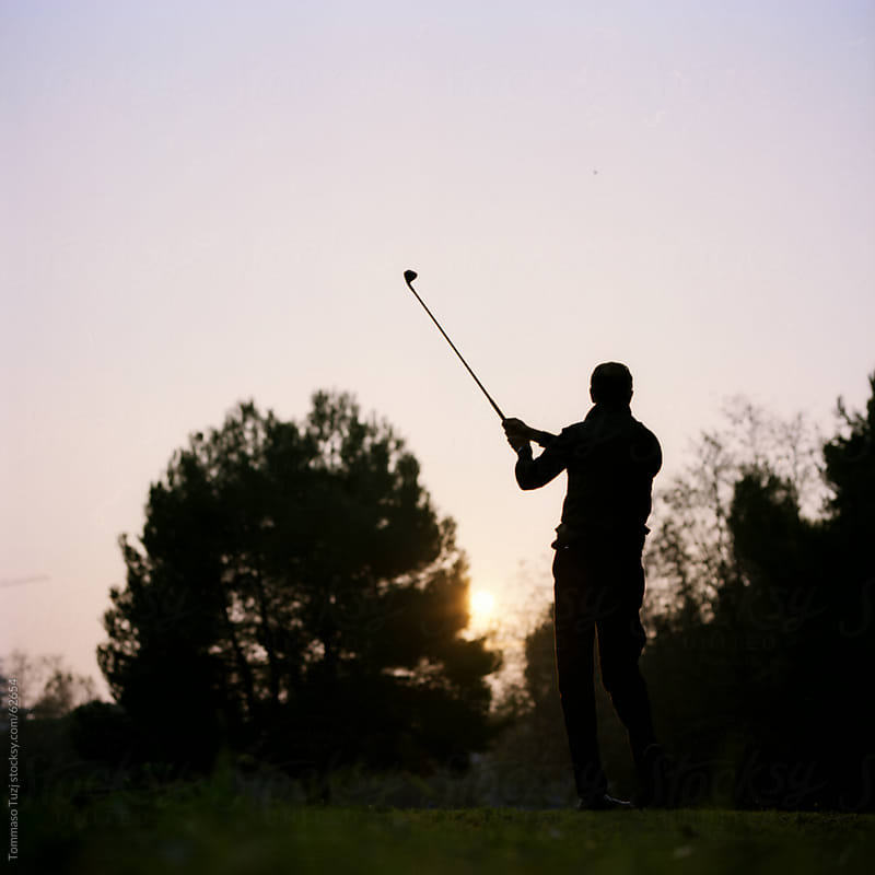 A man playing golf by Tommaso Tuzj for Stocksy United