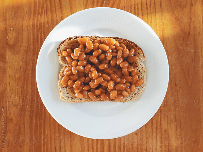 A British breakfast of baked beans on toast by Greg Schmigel for Stocksy United