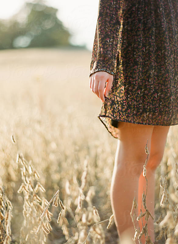 Girl standing in a field by Marta Locklear for Stocksy United
