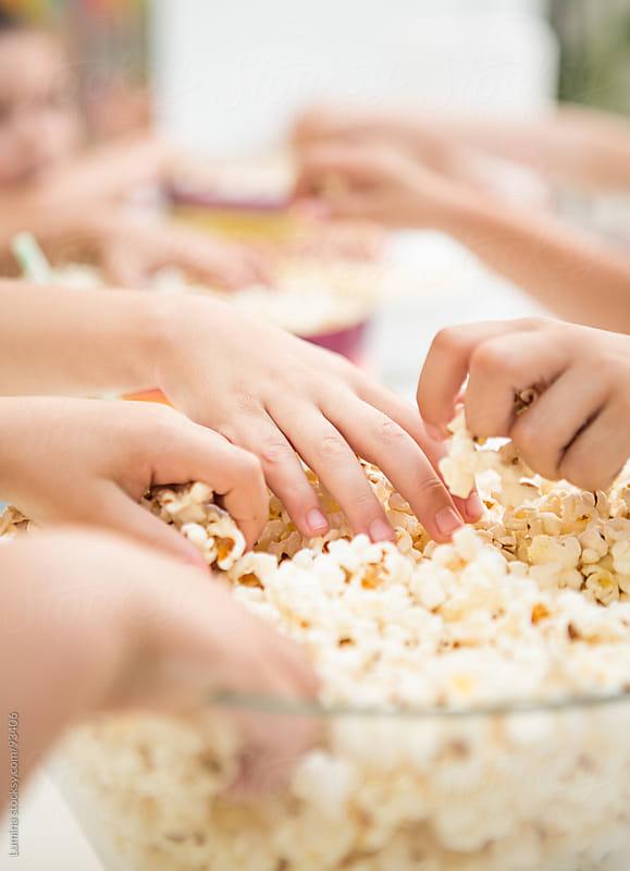 Hands Taking Popcorn by Lumina for Stocksy United