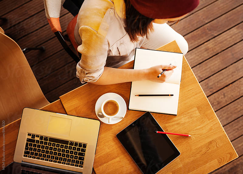 Young woman taking notes by MEM Studio for Stocksy United