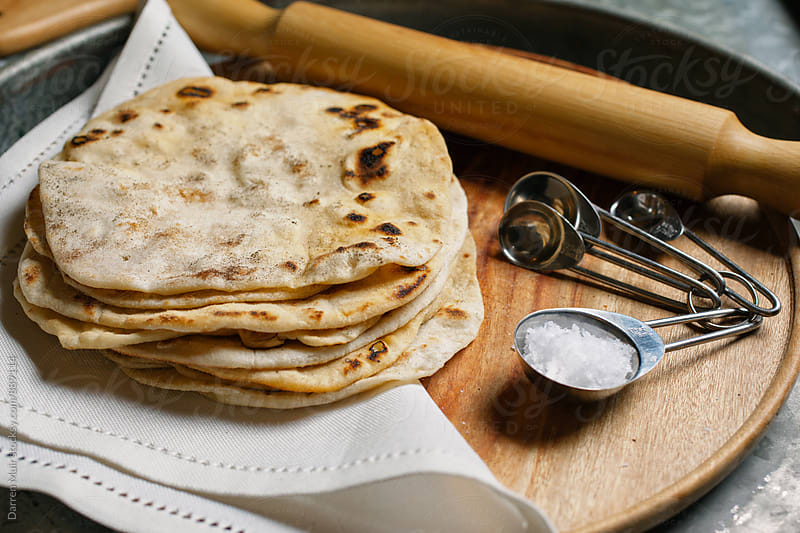 Stack of freshly made tortillas. by Darren Muir for Stocksy United