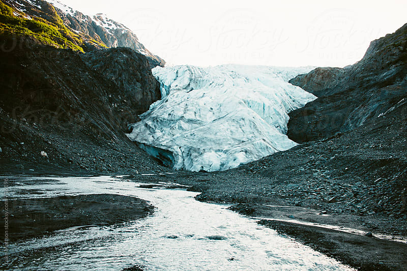 An Icy White Glacier Begets A Clear Cool Stream by Luke Mattson for Stocksy United