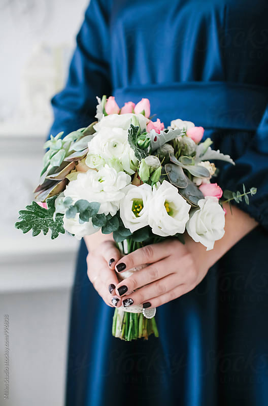 Woman holding bouquet by Milles Studio for Stocksy United