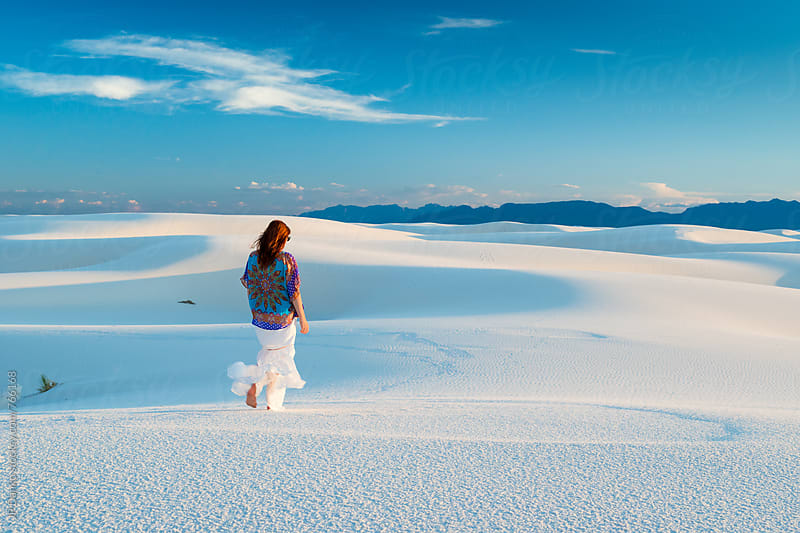Woman In White Skirt Walking Barefoot on Sand Dunes In White Sands National Monument New Mexico by JP Danko for Stocksy United
