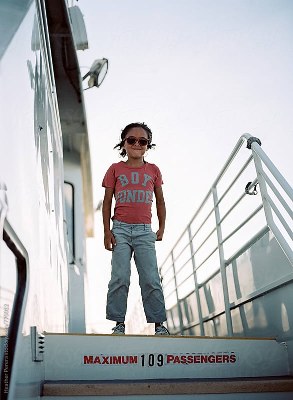 Boy wonder on ferry boat by Heather Perera for Stocksy United