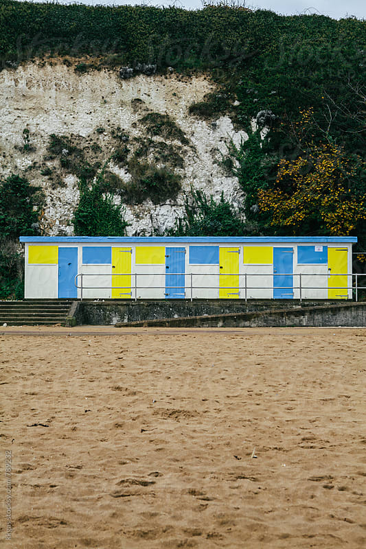 Beach huts on the beach in a typical English seaside resort. by kkgas for Stocksy United