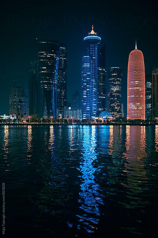 Night skyline of Doha, Qatar by Maja Topcagic for Stocksy United