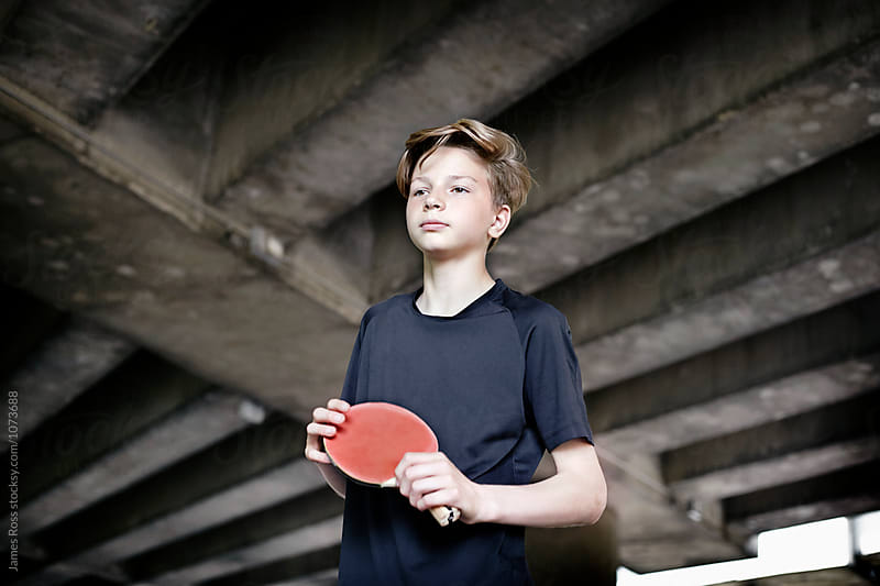 Teenager playing table tennis by James Ross for Stocksy United
