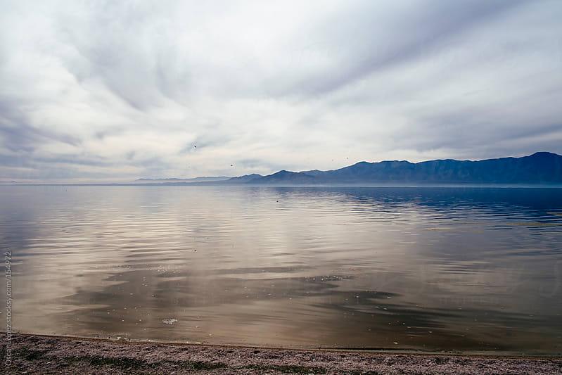 Salton Sea on cloudy day by Oscar Lopez for Stocksy United