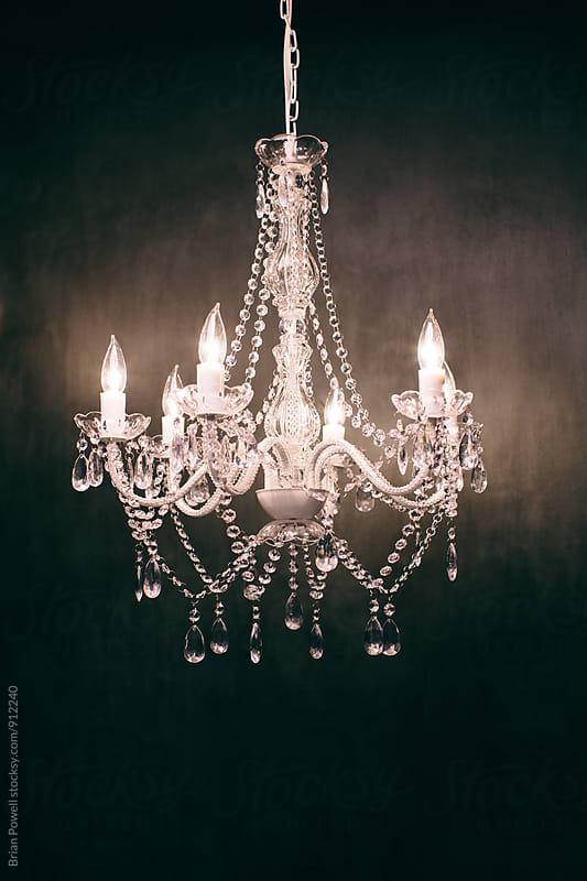 fancy white chandelier  by Brian Powell for Stocksy United