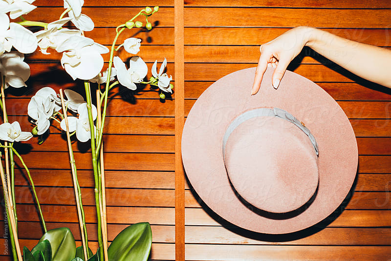 Concept. Hat and Orchid. by Studio Firma for Stocksy United