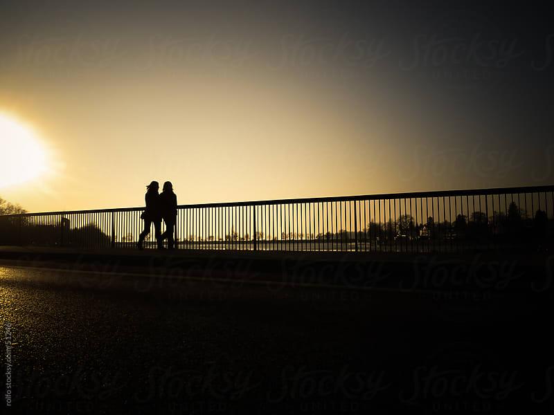 stroll walk friends silhouette bridge by rolfo for Stocksy United