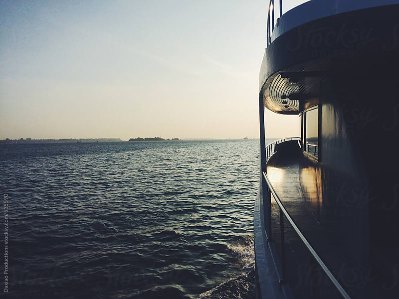Sunset boat journey by Daxiao Productions for Stocksy United