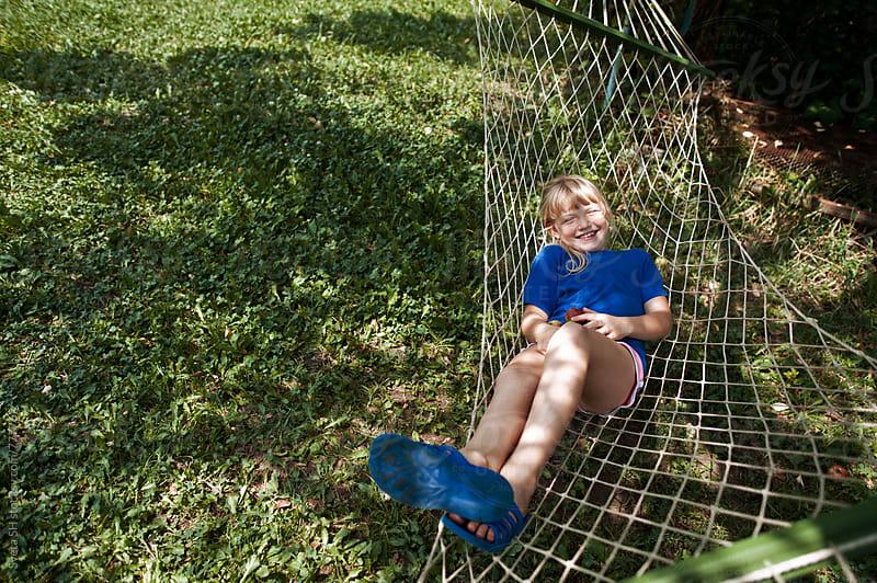 The girl in a hammock  by Sveta SH for Stocksy United