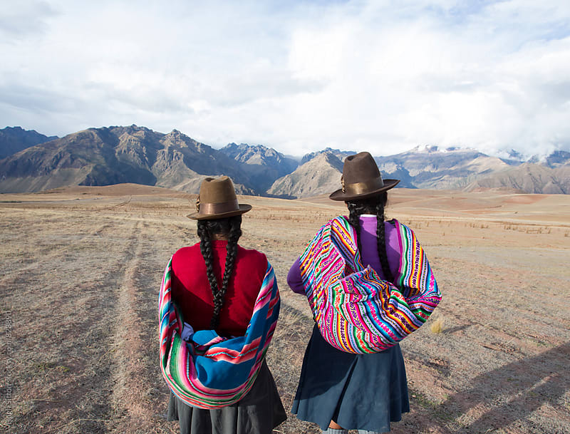 Peruvian women wearing traditional costume. Peru. by Hugh Sitton for Stocksy United