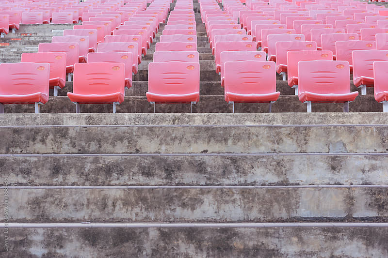 Red tiered seats of theater by Lawren Lu for Stocksy United