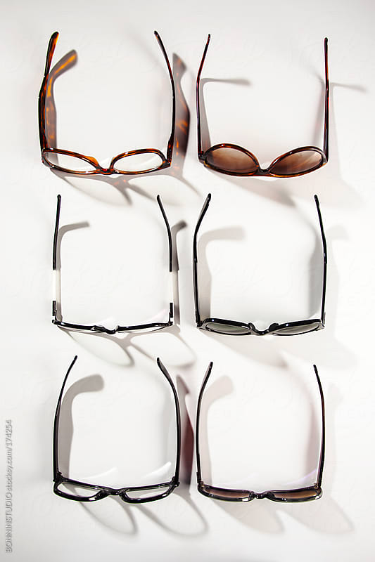 Overhead of  glasses and sunglasses set over white background. by BONNINSTUDIO for Stocksy United