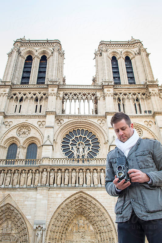 Photographer at Notre Dame de Paris with Vintage Medium Format Film Camera by JP Danko for Stocksy United
