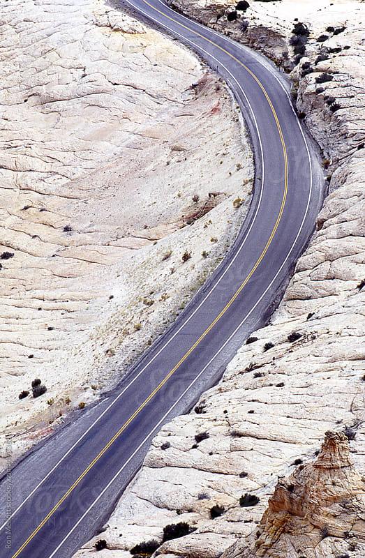 blacktop asphalt road roadway highway through Escalante National Monument Utah by Ron Mellott for Stocksy United