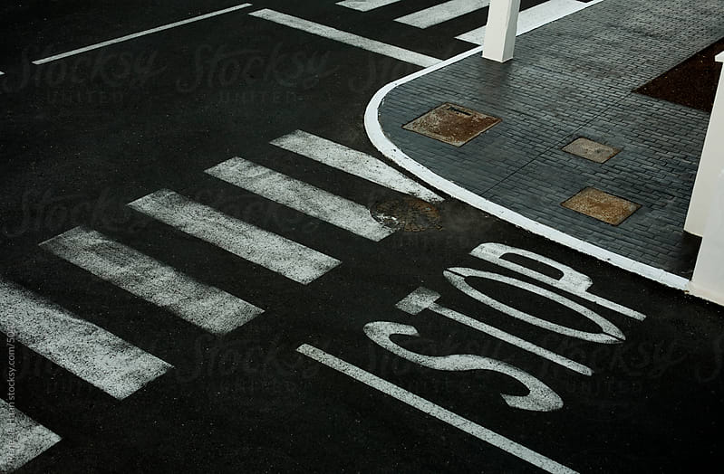 stop-sign on street by Rene de Haan for Stocksy United