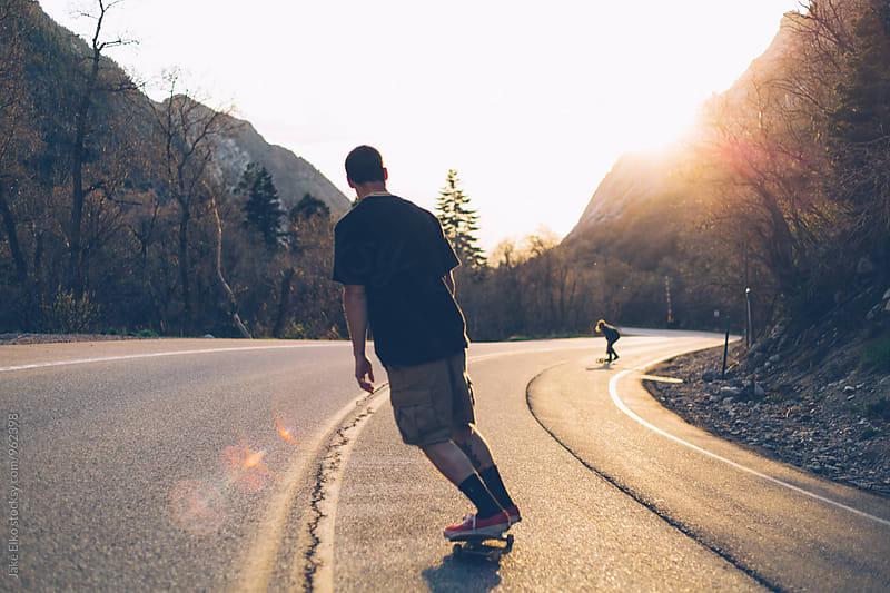 A Skateboarder Bombing Down Hill by Jake Elko for Stocksy United