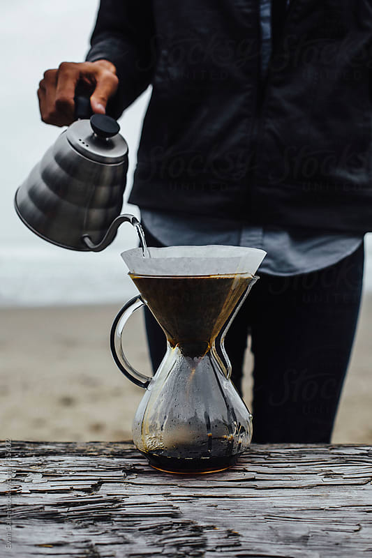 Making Coffee On The Beach Chemex by Evan Dalen for Stocksy United