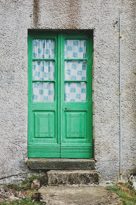 Old wood door and decaying stone building in Italian village by Laura Stolfi for Stocksy United