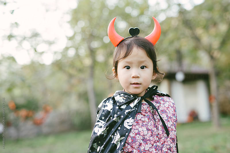Toddler girl wearing halloween costume by Maa Hoo for Stocksy United