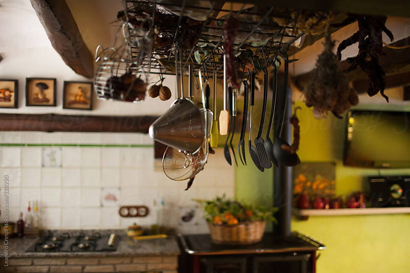 Kitchen tools hanging by Leandro Crespi for Stocksy United